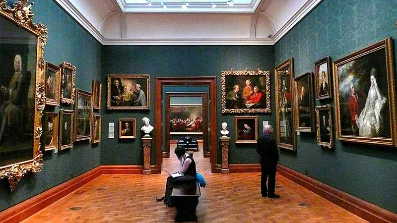A room with numerous portrait paintings in the National Portrait Gallery