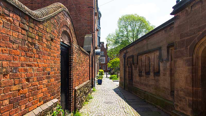 A narrow stone street in Leicester, England